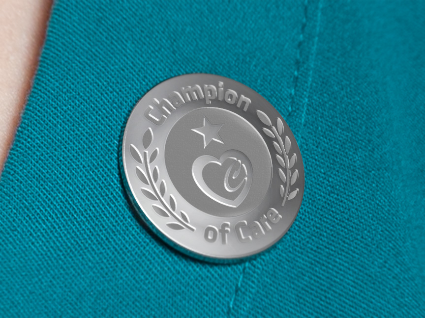 Bill Rogers Design - Fairview Foundation - Champions of Care Pin Design